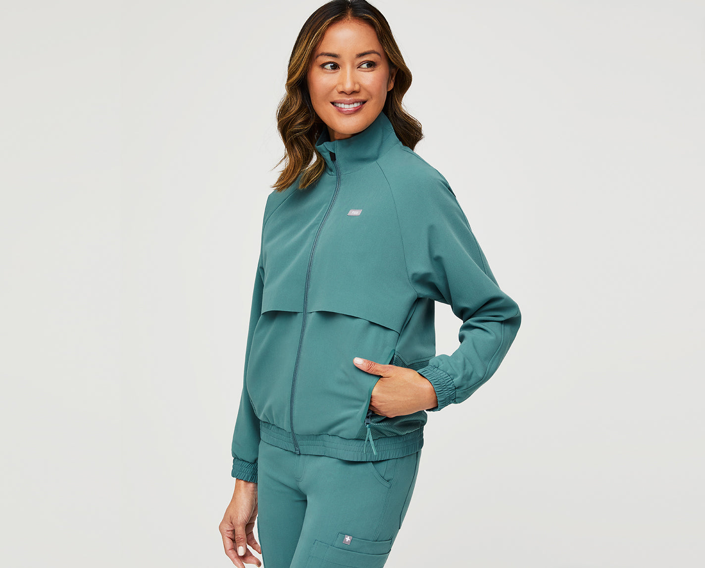 Cool on every layer. The Sydney Scrub Jacket features a front yoke vent for airflow and ventilation, a mesh lining for extra breathability, TPU trim and detailing, five functional pockets and both our proprietary FIONx fabric and eco-friendly FIONlite fabric. Like, the coolest.
