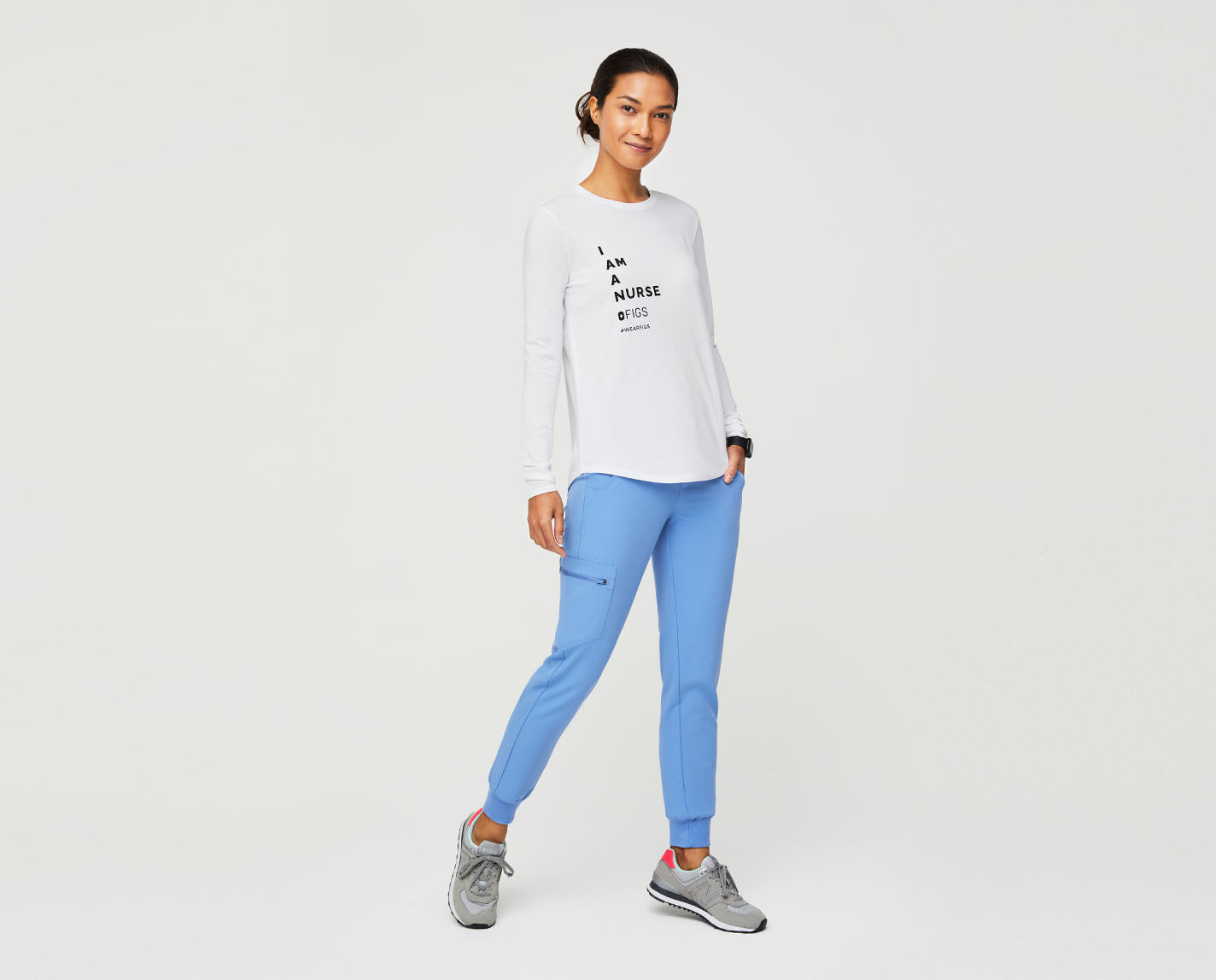 """Be proud of who you are. The special """"I Am A Nurse"""" Underscrub has a relaxed fit, subtle curved hem and, of course, a graphic on the chest letting everyone know that you are proud to be a nurse."""
