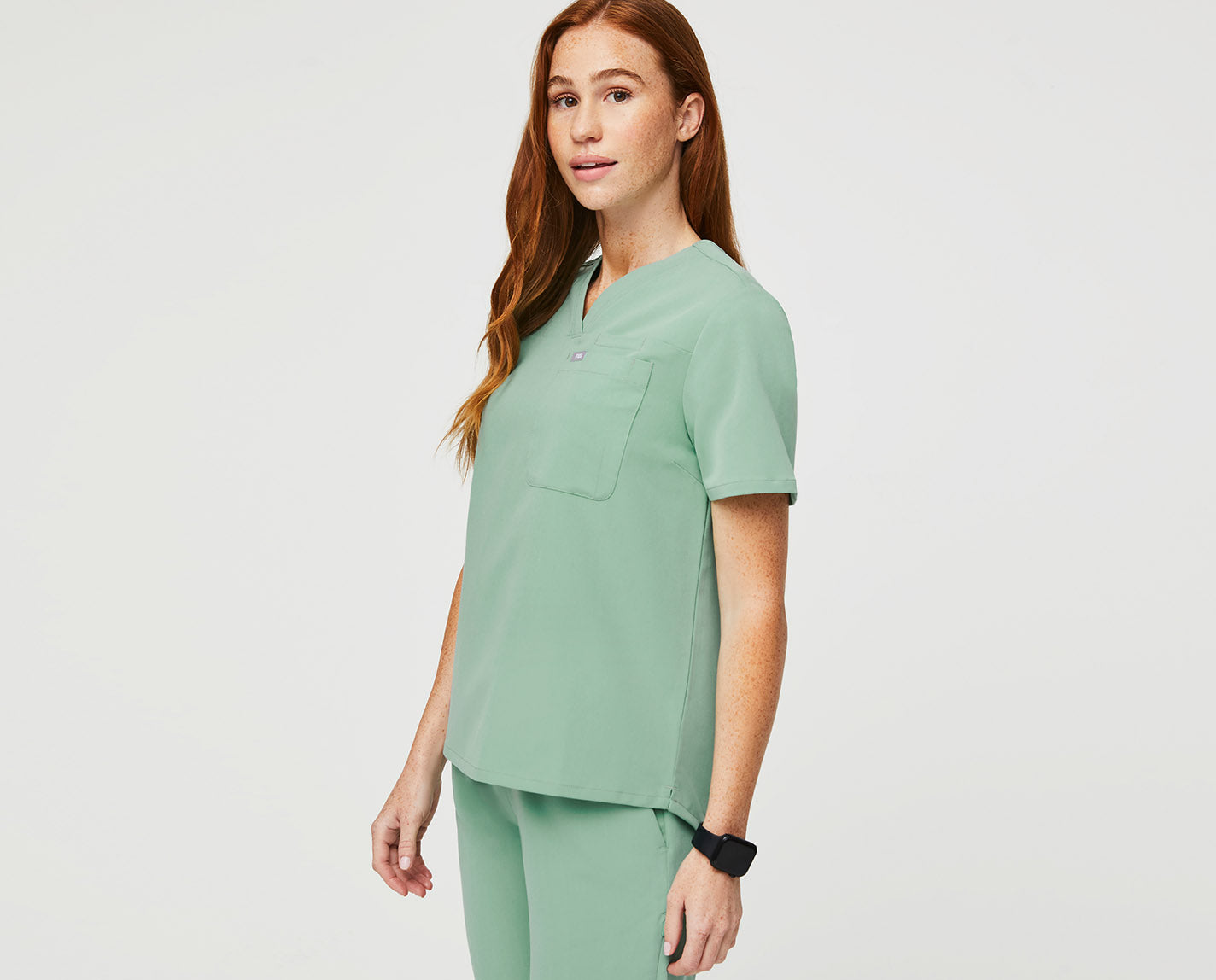 This classic fit V-neck is all about style and utility. With a total of 3 pockets, it has everything you need for a busy day on shift. It is made with our proprietary FIONx fabric and available just in time for this summer.