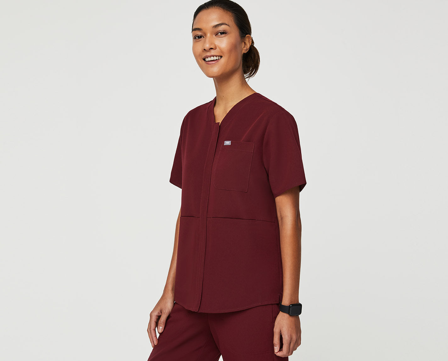A relaxed V-neck top with all the right moves. It's designed with three pockets for everything you need, plus a full zip v-neck, and a slightly curved high-low hem with side slits for better movement on the go.