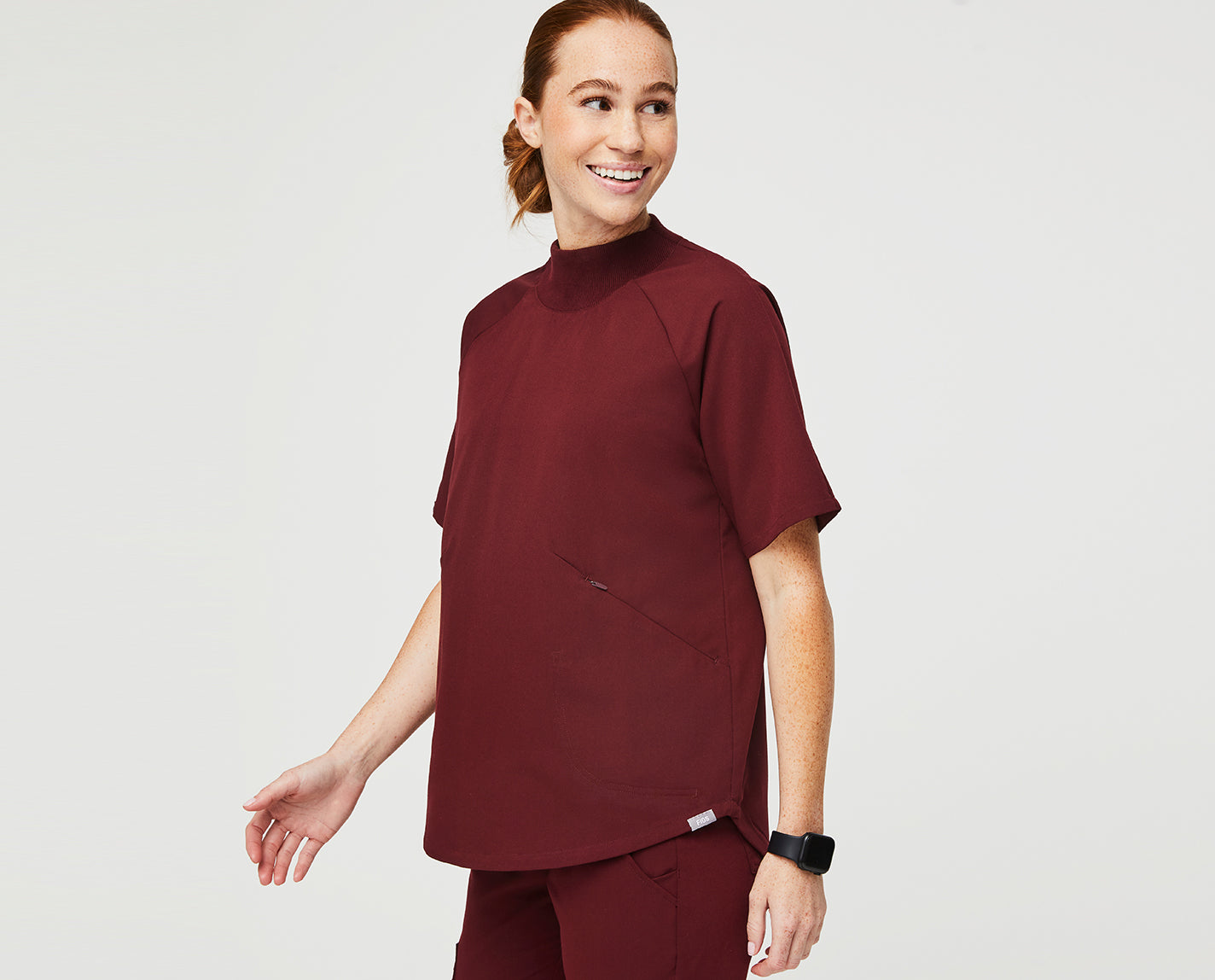 Like you have any time to relax during your busy schedule. This relaxed mock neck top helps keep things moving in the right direction with its raglan sleeve and an oversized fit for keeping you in the game.