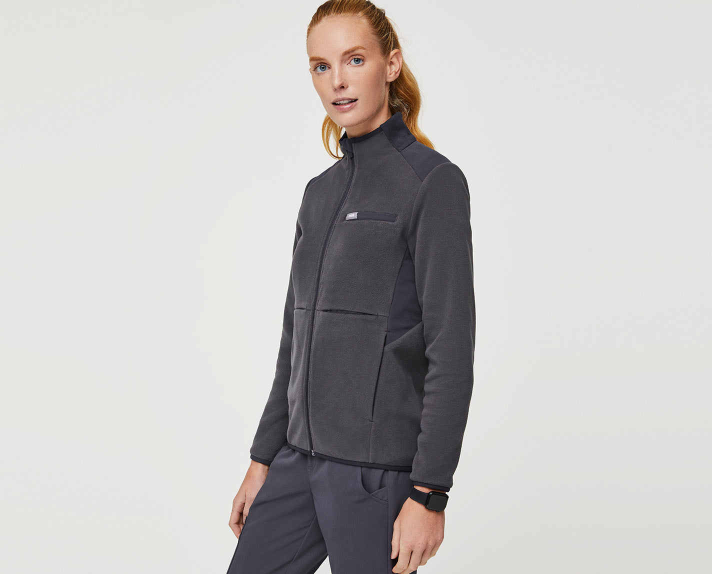This jacket has it all: warmth, comfort, style and functionality. Made of a plush, anti-pilling fleece with FIONx fabric, it's the ideal layer to combat A/C-friendly hospitals or unpredictable weather patterns. Or the frozen food section of the grocery store. And, yes, of course it has lots of pockets