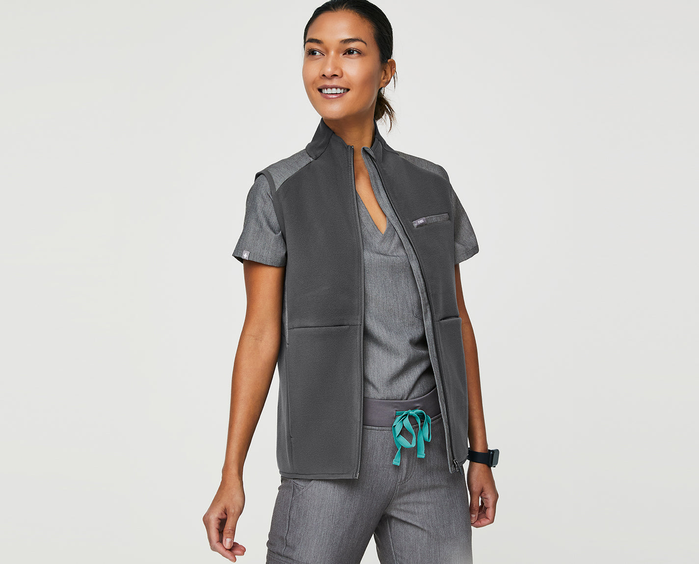 Clear eyes. Warm Core. Can't lose. Our full-zip On-Shift Vest keeps your core warm without limiting your range of motion. Plus, it features a contrasting front panel and back yoke made from our proprietary FIONx fabric so that it matches your scrubs perfectly.