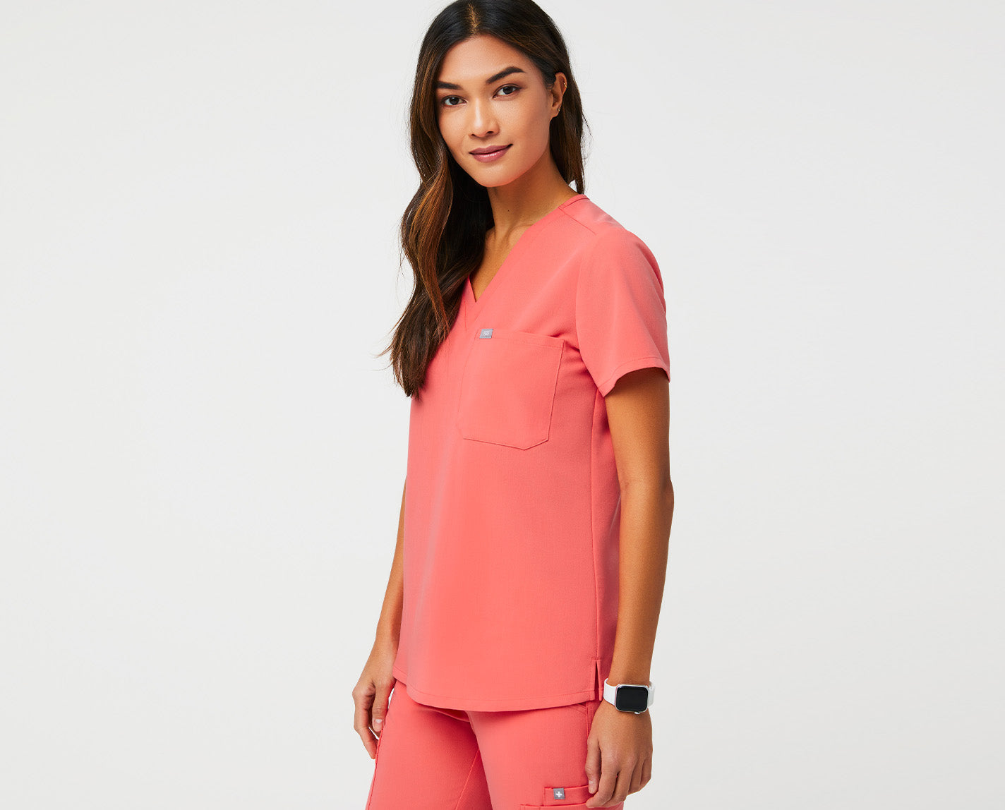 Simple and clean, but far from basic. The Catarina has a flattering V-neck, single chest pocket and slim (but not too slim) fit — plus it features our proprietary FIONx fabric. Ta-da.