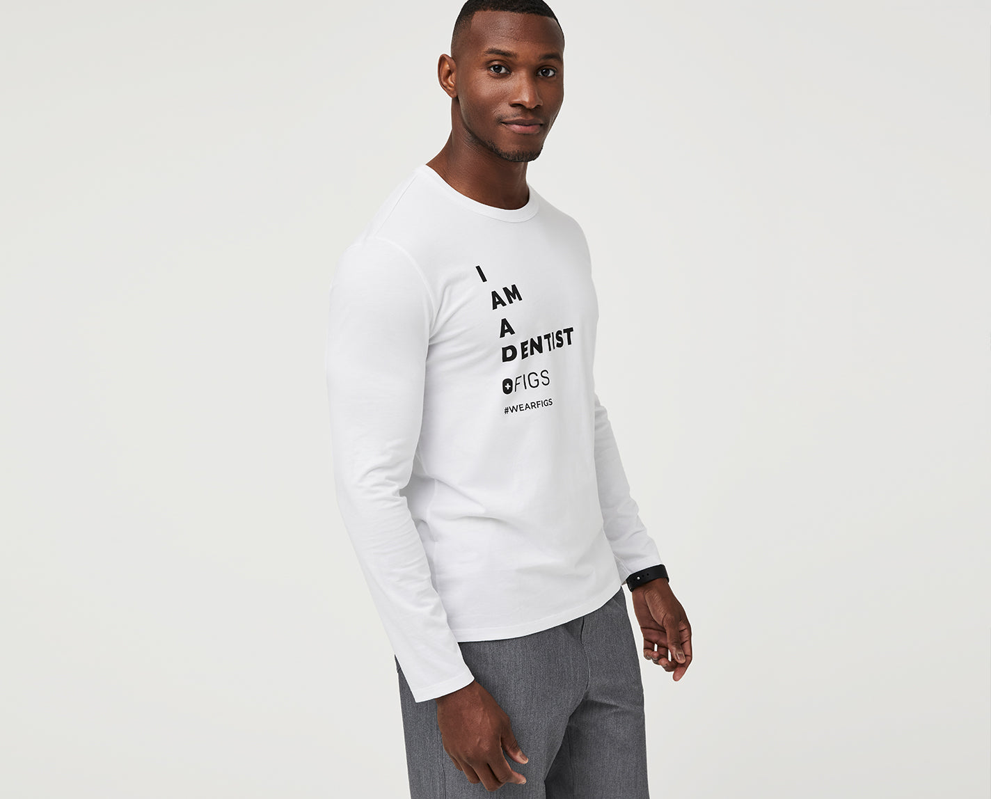 """Teeth are your business. The special """"I Am A Dentist"""" Underscrub has a relaxed fit, subtle curved hem and, of course, a graphic on the chest letting everyone know that healthy teeth and gums are your thing."""