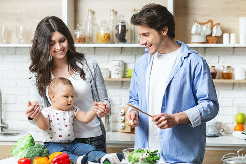 parents prepare lunch with baby