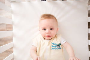 Close up of baby in Cream Magic Dream Sack