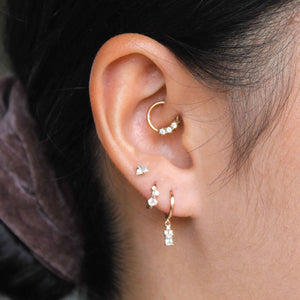 Triple Stone Huggies in Rose Gold in second lobe piercing