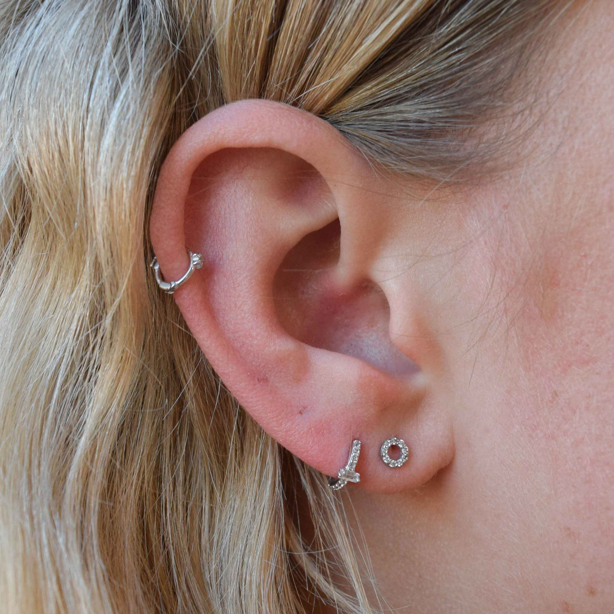 Baguette Gem Clicker in Silver worn in second lobe piercing