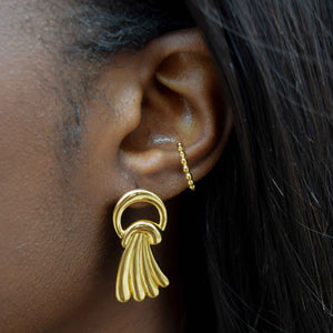 basic beaded ear cuff and water fall stud earrings in gold on ear