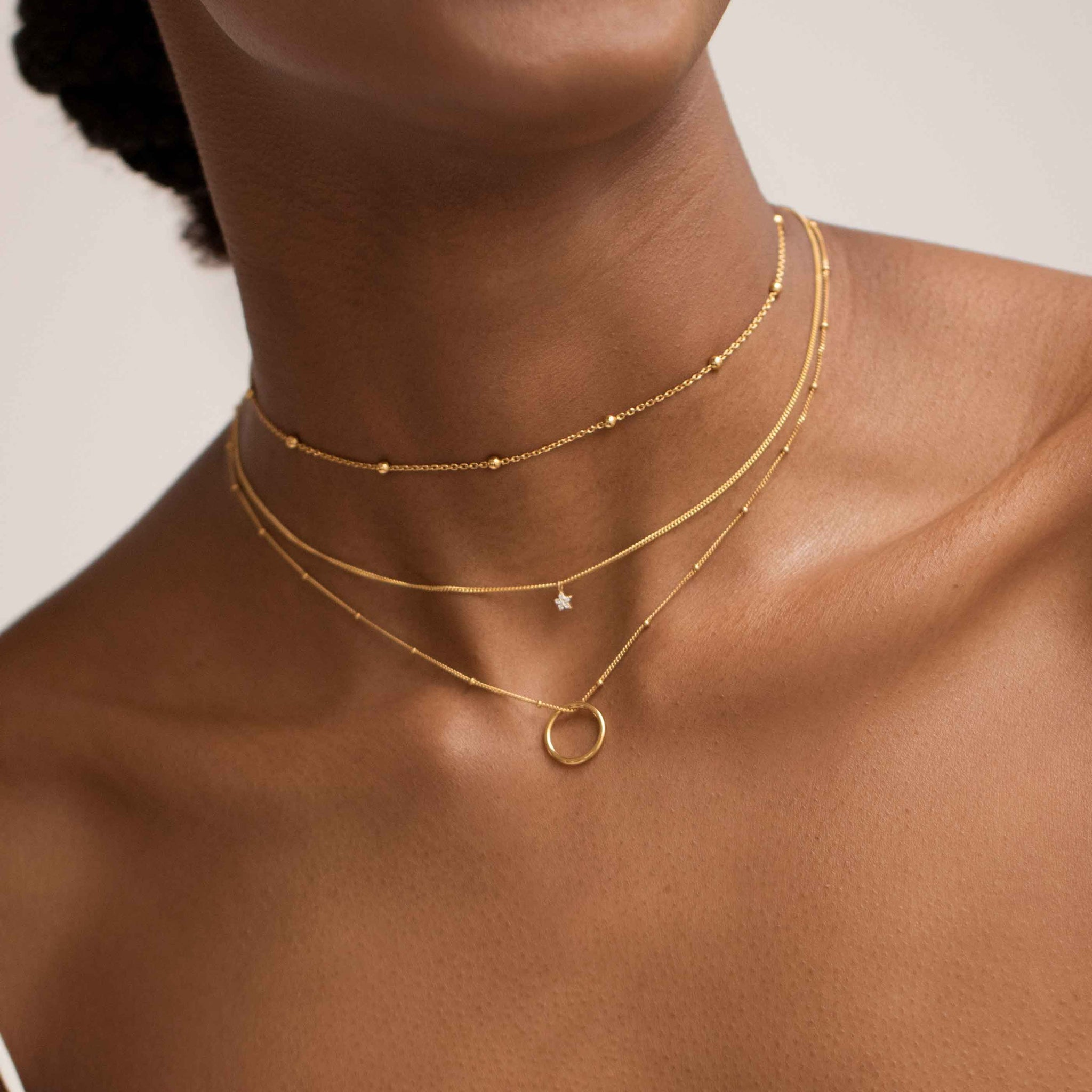 Basic Halo Pendant Necklace in Gold worn with gold necklaces