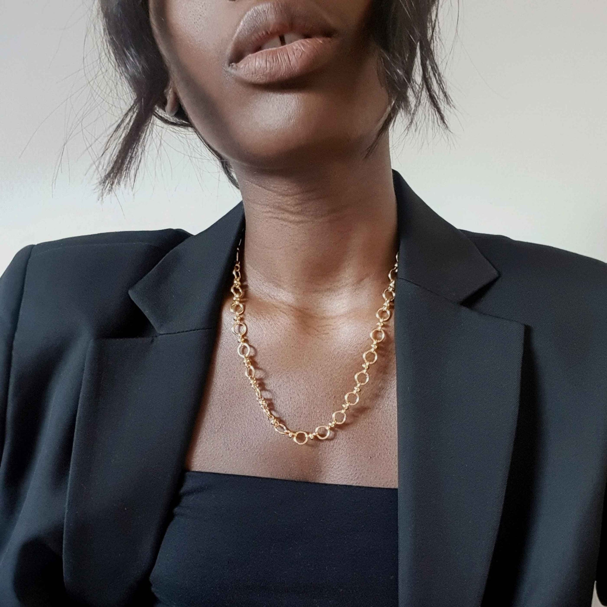 Circle Link Chain Necklace in Gold worn with black blaxer