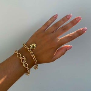Coin Pendant Chunky Bracelet in Gold worn with vintage chunky bracelet