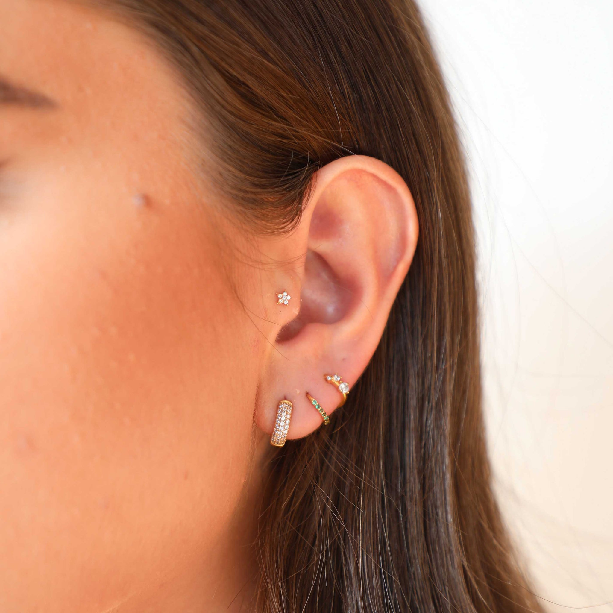 jewelled star barbell worn in tragus piercing