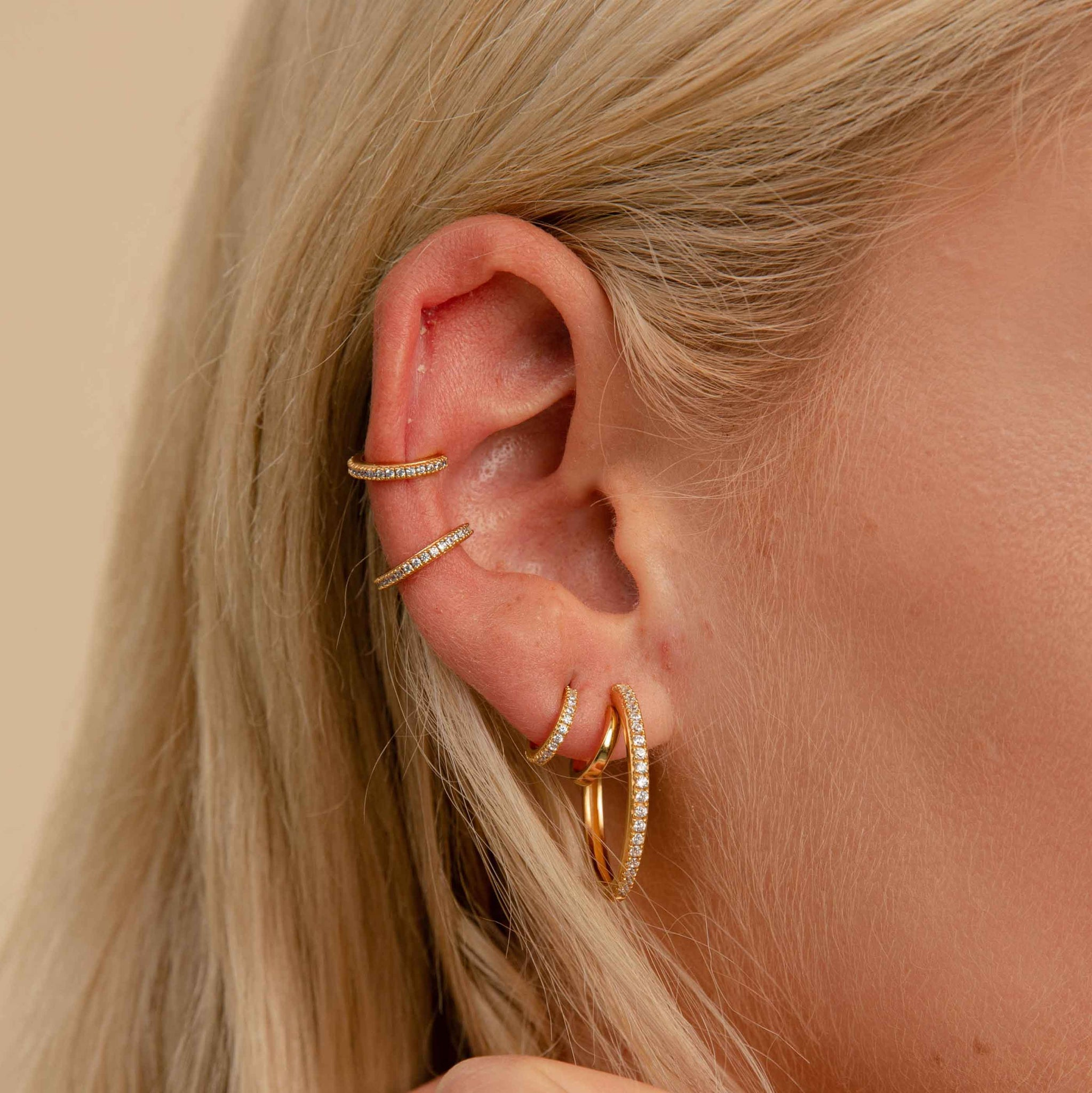 Crystal Ear Cuff in Gold worn with jewelled earrings