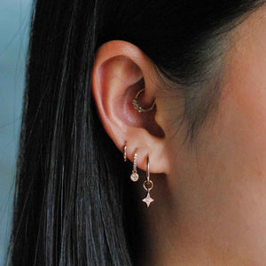 Etched Star Hoops in Rose Gold worn with huggies