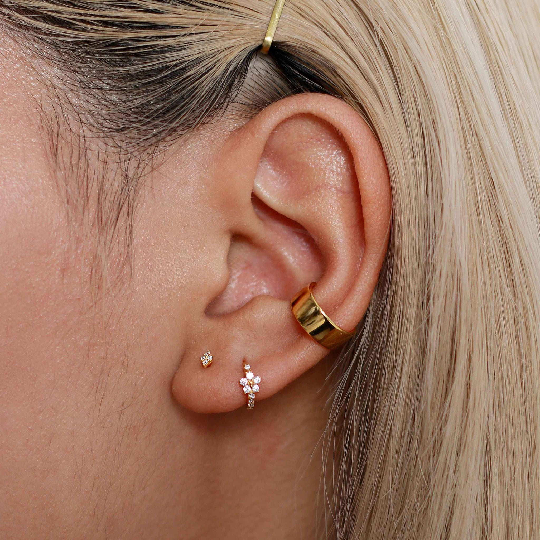 Gem Flower Clicker in Gold worn in second lobe piercing