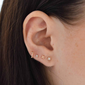Gem Star Clicker in Rose Gold worn in upper lobe piercing