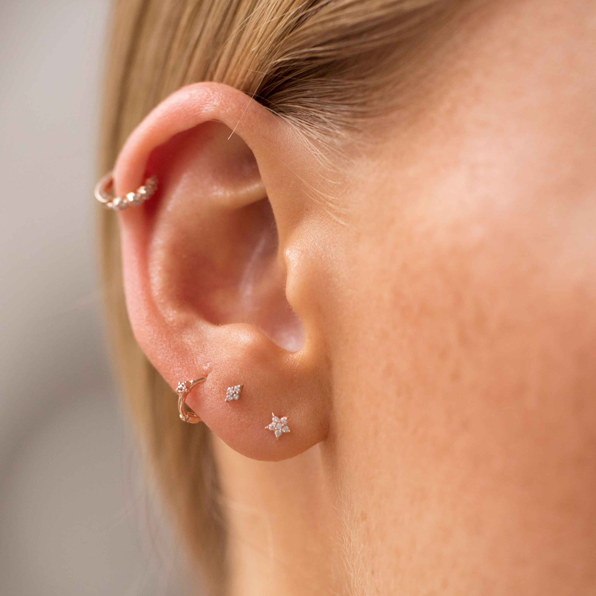 Gem Star Clicker in Rose Gold worn in third lobe piercing