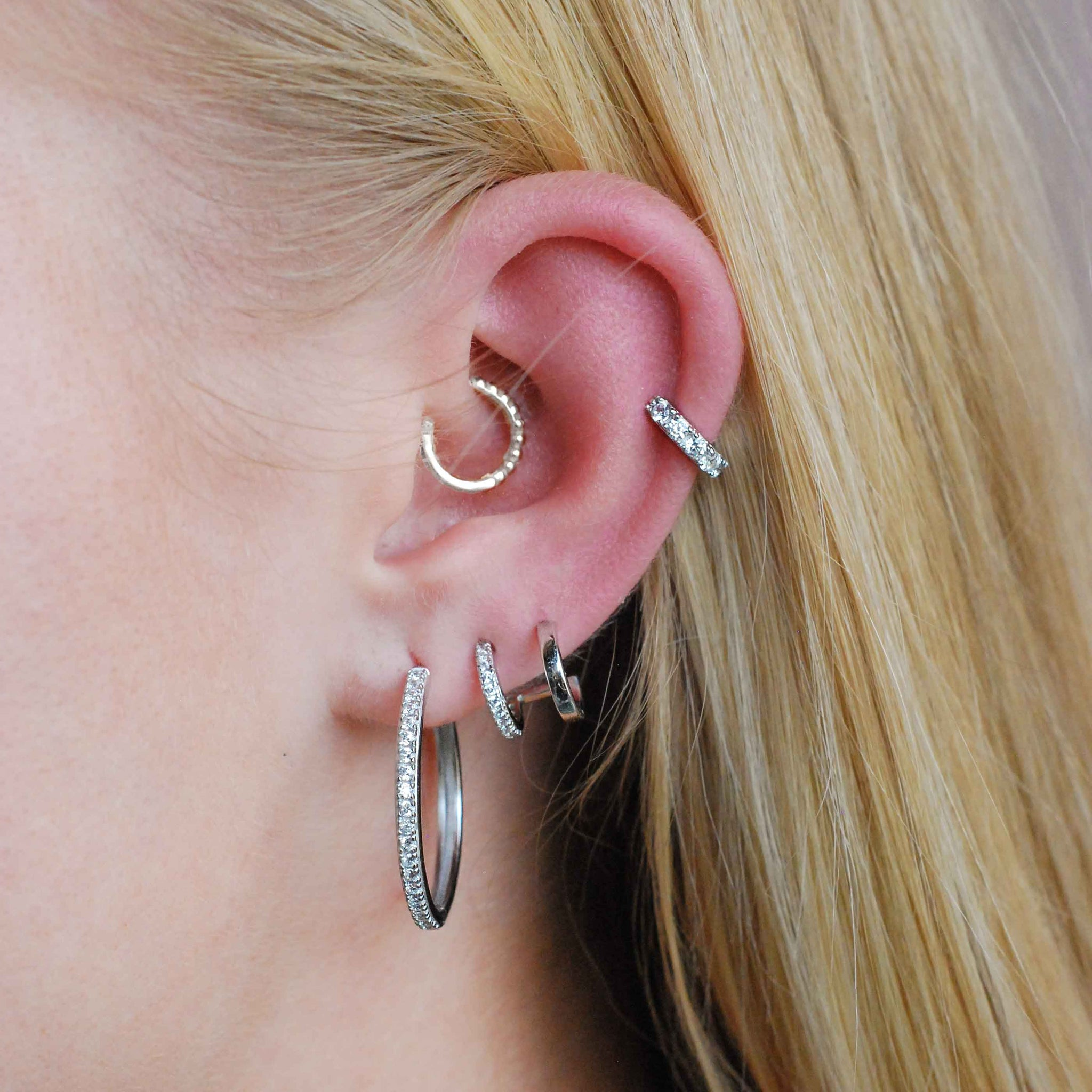 Illusion Stud Earrings in Silver worn with hoops