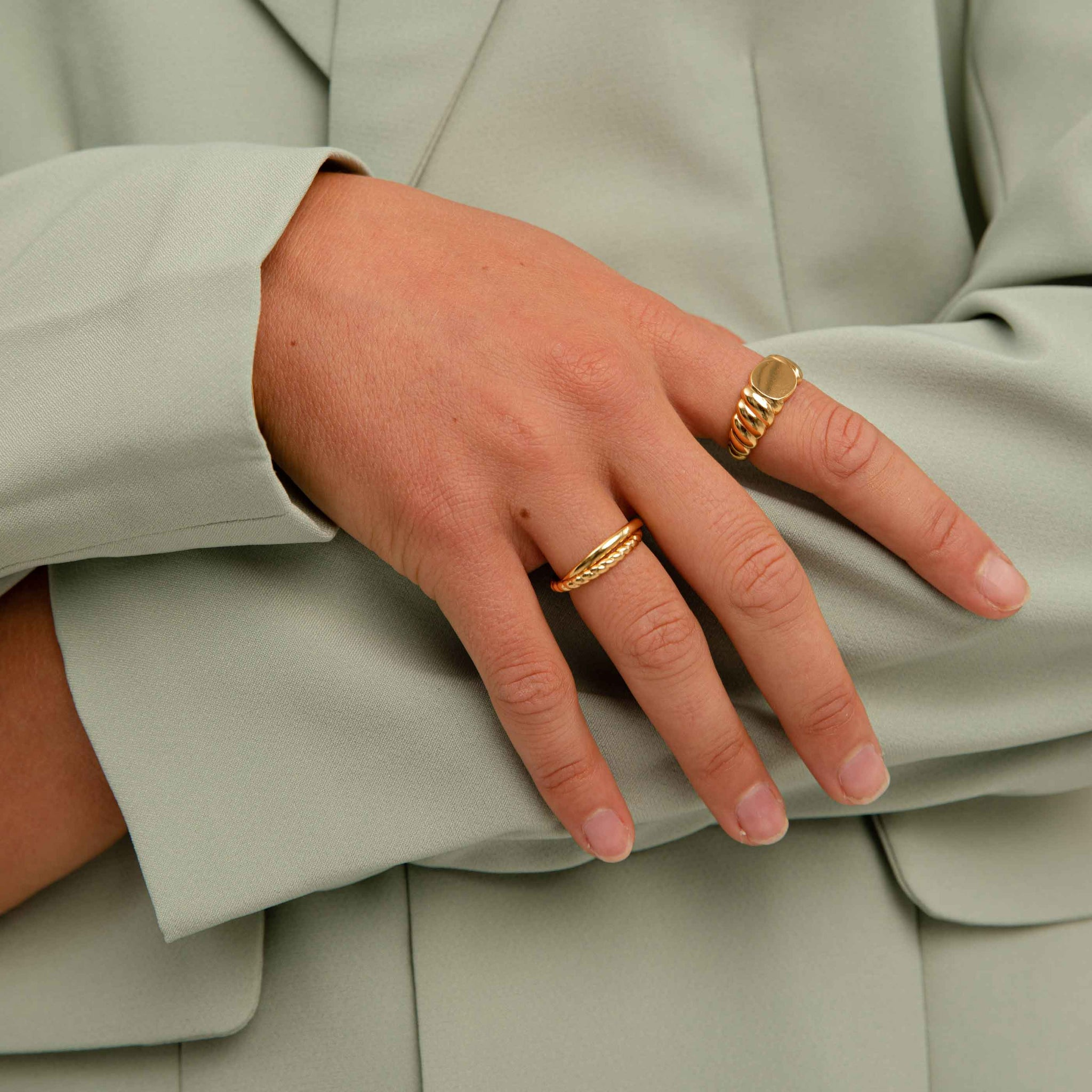 Interlocked Rope & Plain Band Ring in Gold on finger