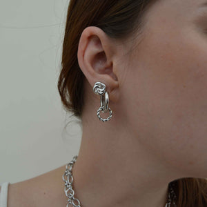 Knot Stud Earrings in Silver worn with silver hoops
