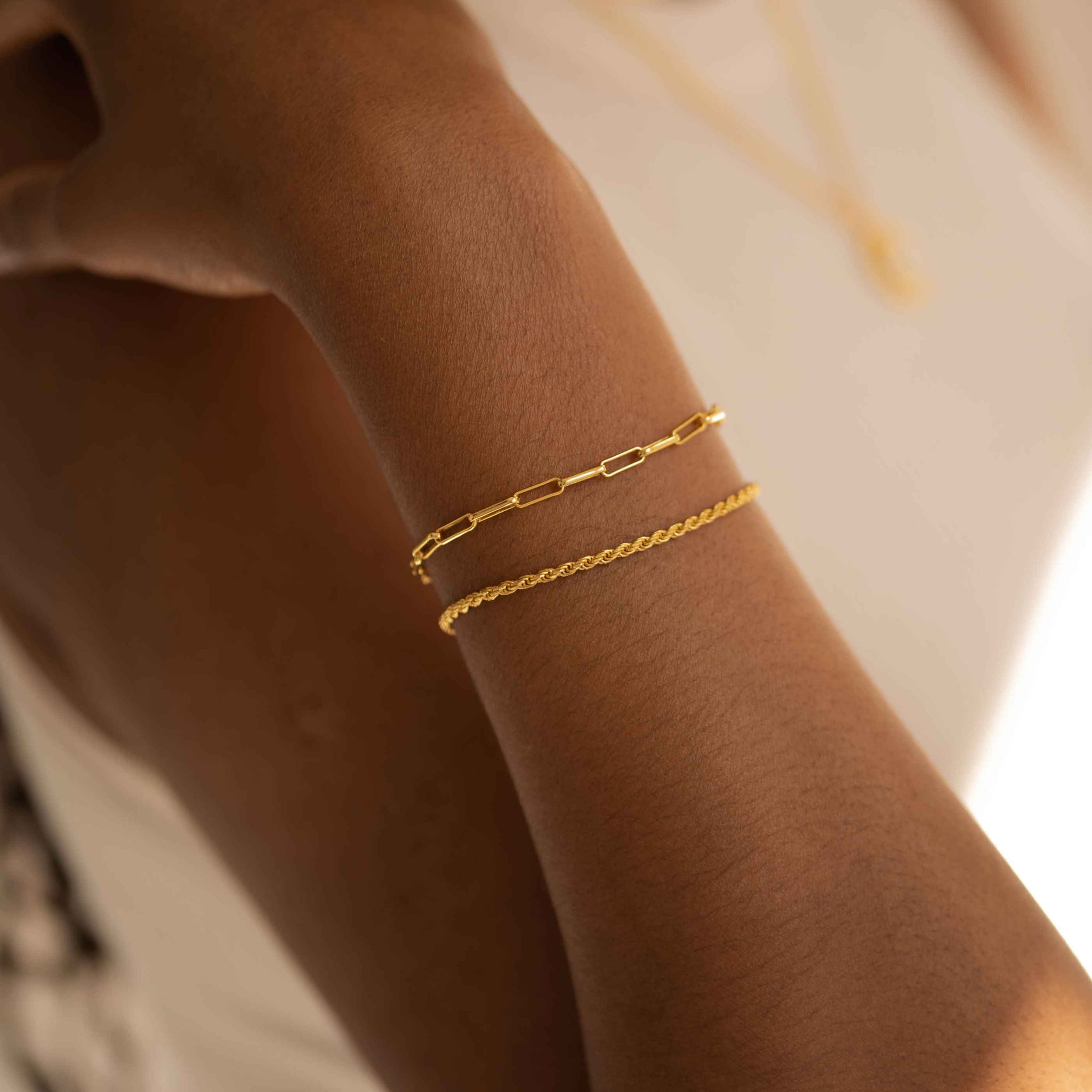 Long Link Chain Bracelet in Gold worn with rope chain bracelet