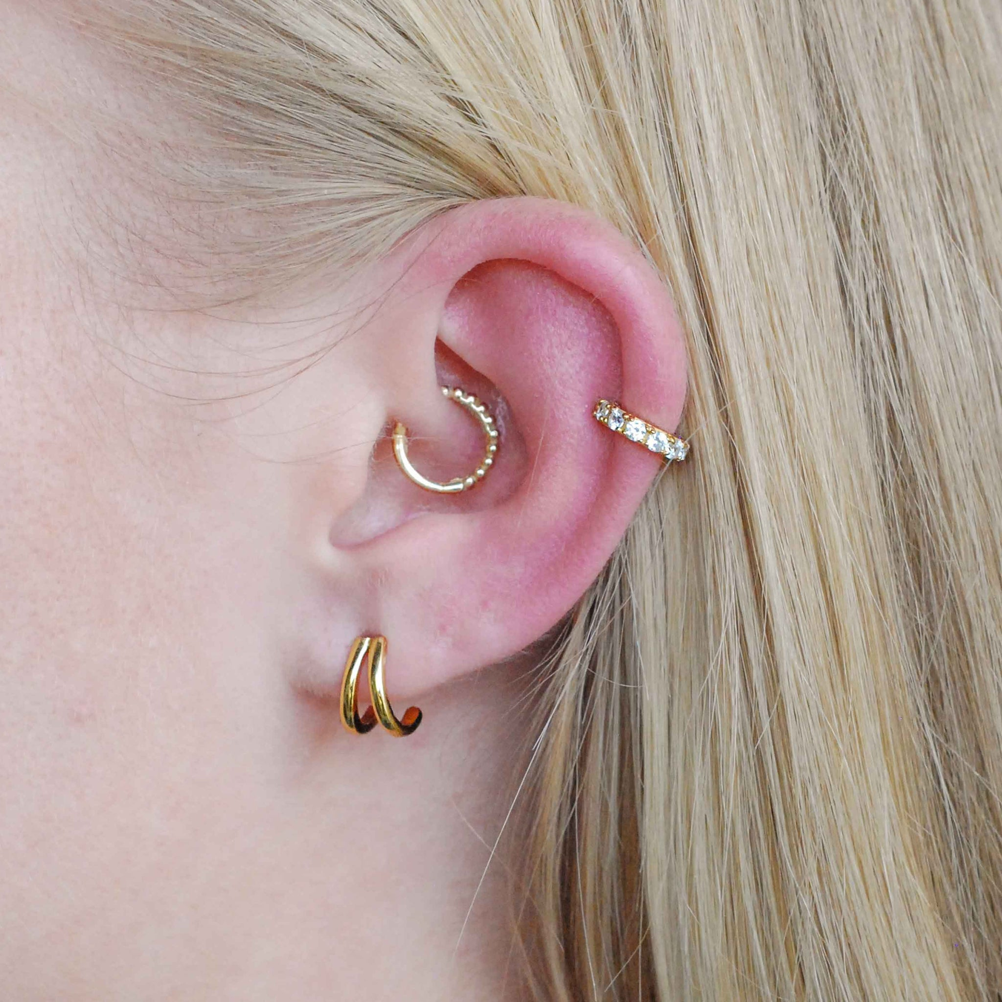 Mini Wishbone Ear Cuff in Gold worn with double bar stud earrings