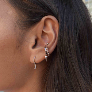 Mystic Moon Huggies in Rose Gold worn with rose gold ear cuffs