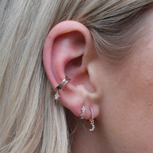 Mystic Moon Huggies in Rose Gold worn with gem huggies and rose gold ear cuffs