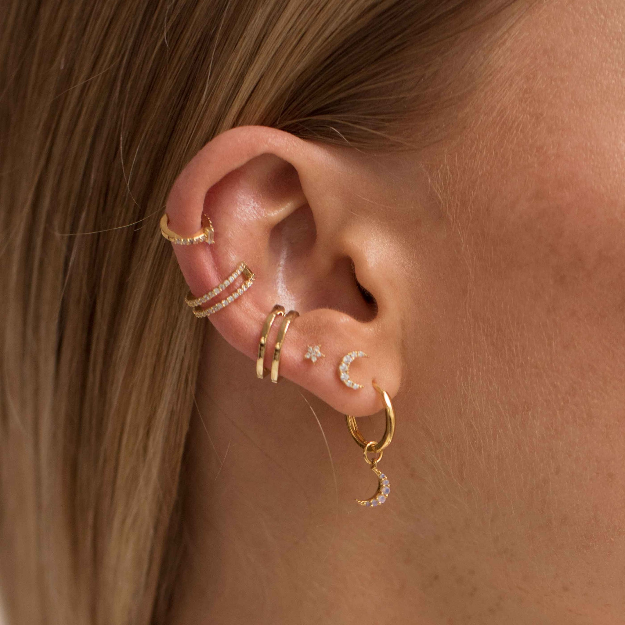 Mystic Moon Pendant Earrings in Gold worn with barbells and ear cuffs