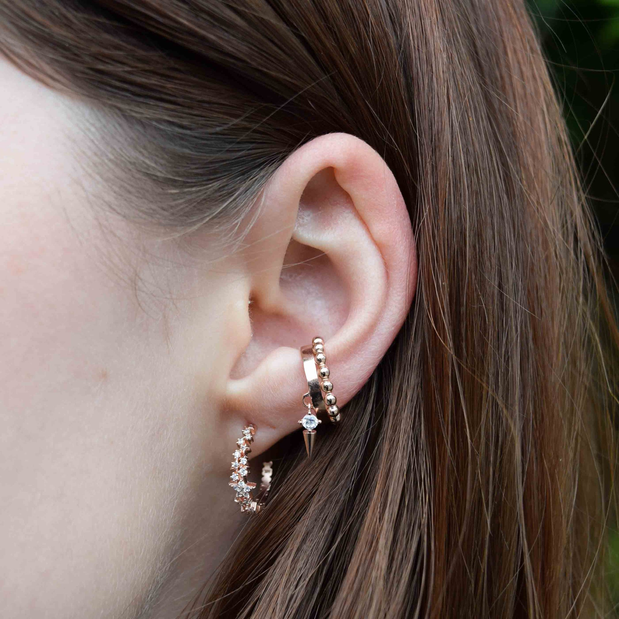 Mystic Star Hoops in Rose Gold worn with ear cuffs