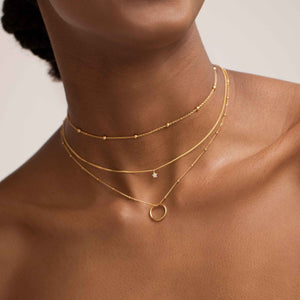 Mystic Star Necklace in Gold worn with beaded choker and pendant necklace