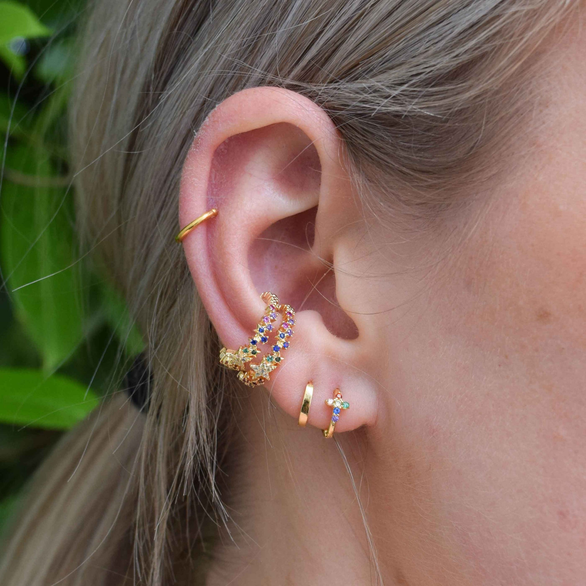 Rainbow Star Ear Cuff in Gold worn with gold huggies