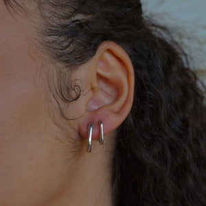 Rectangular Hoops in Silver worn with rectangular huggies
