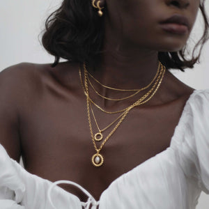 Rope Ring Pendant Necklace in Gold layered with gold necklaces