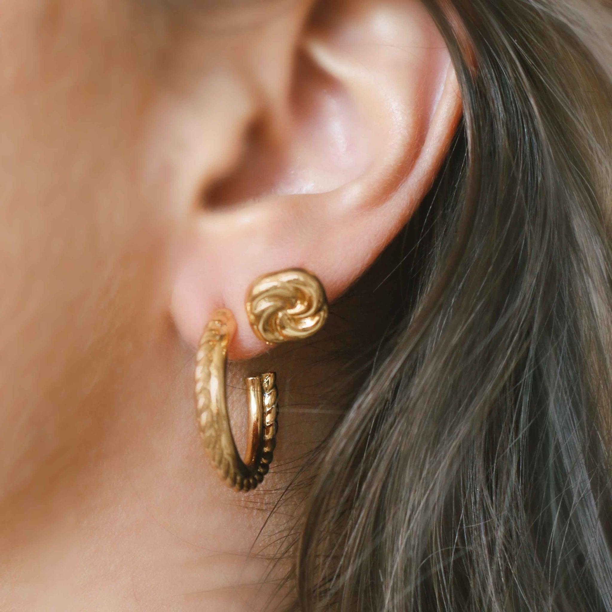 Knot Stud Earrings in Gold worn with gold hoops
