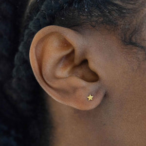 Simple Star Barbell in Gold on Ear