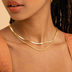 Snake Chain Necklace in Gold worn with rope chain necklace in gold