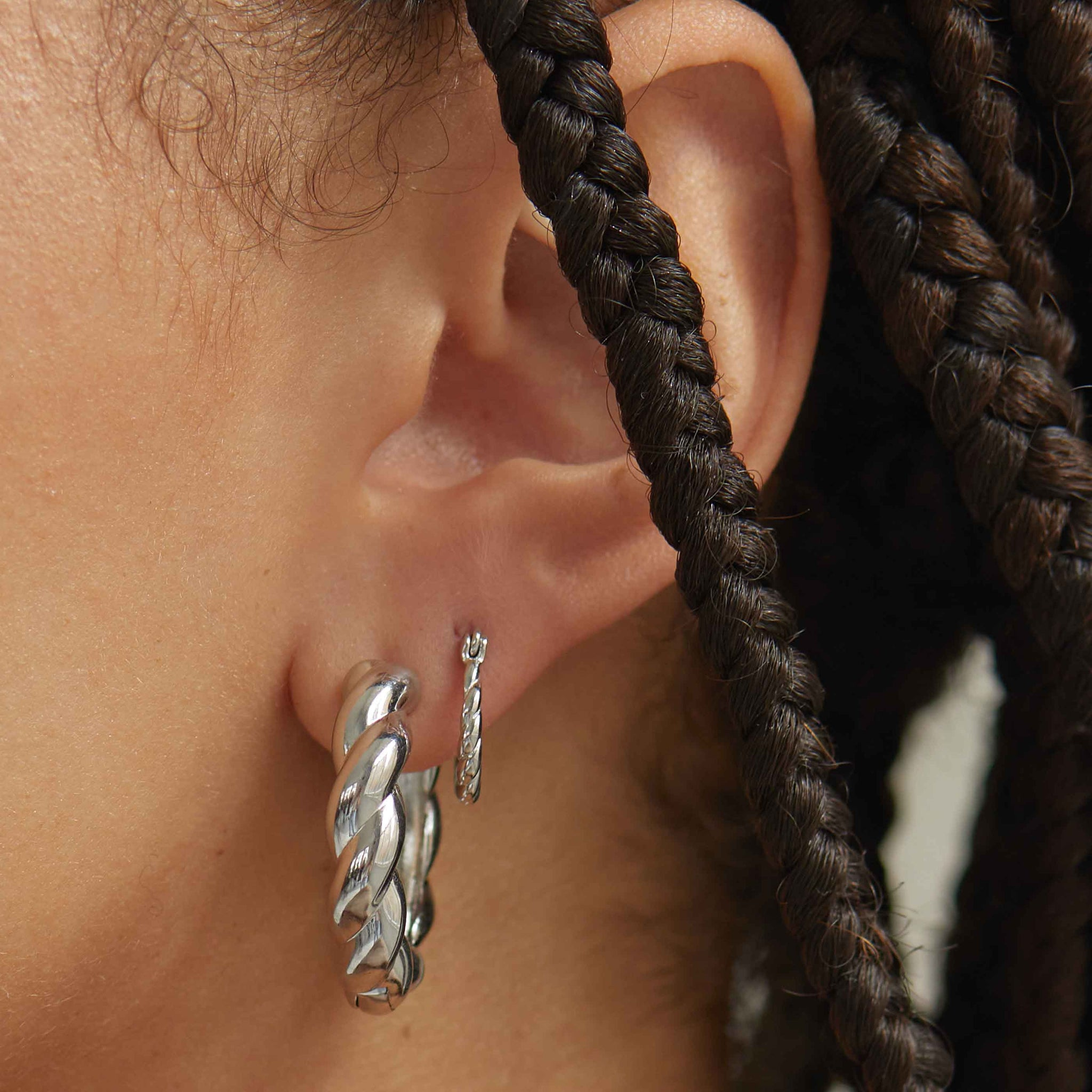 twisted mini hoops worn with chunky hoops in silver