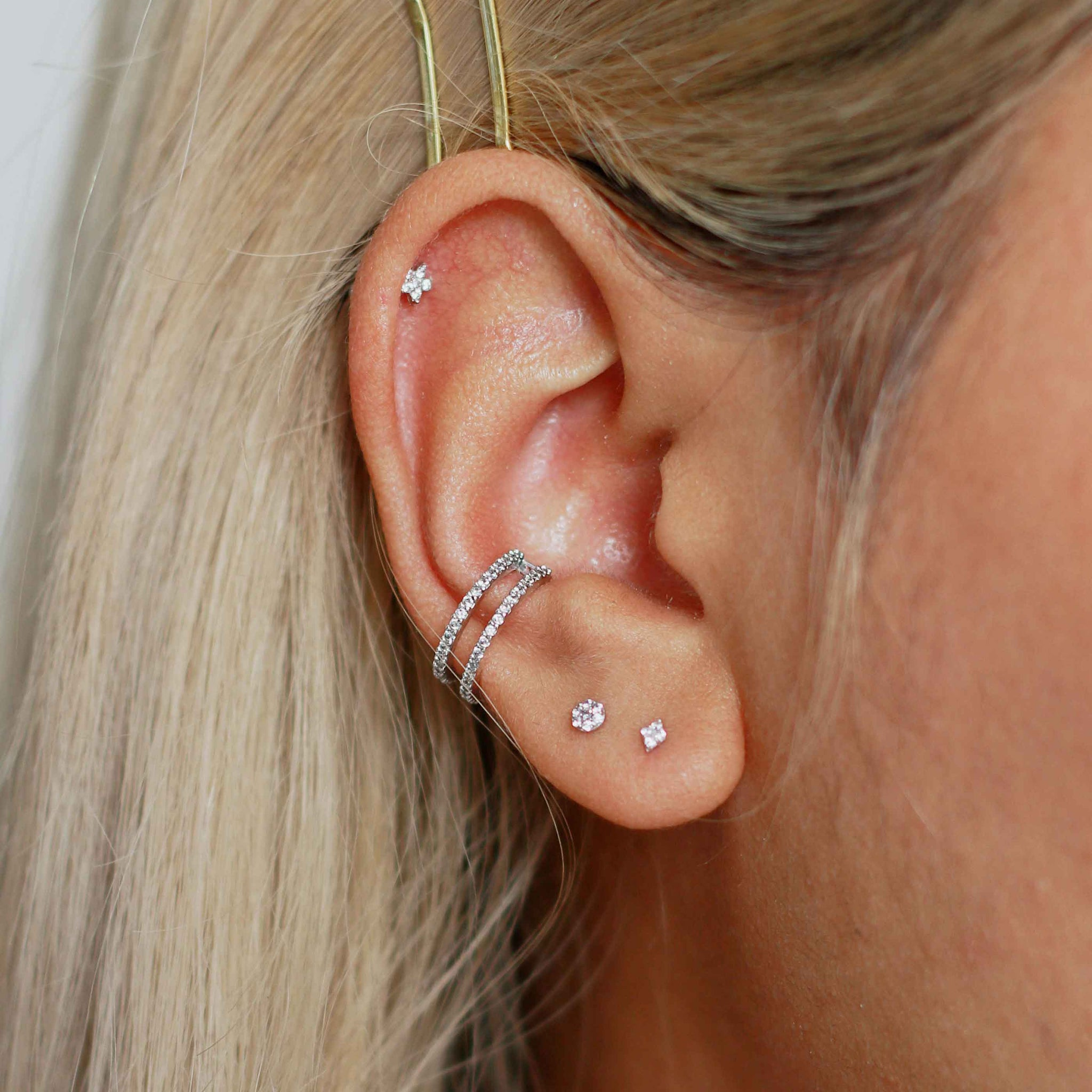 cubic zirconia encrusted wishbone ear cuff in silver on ear stack