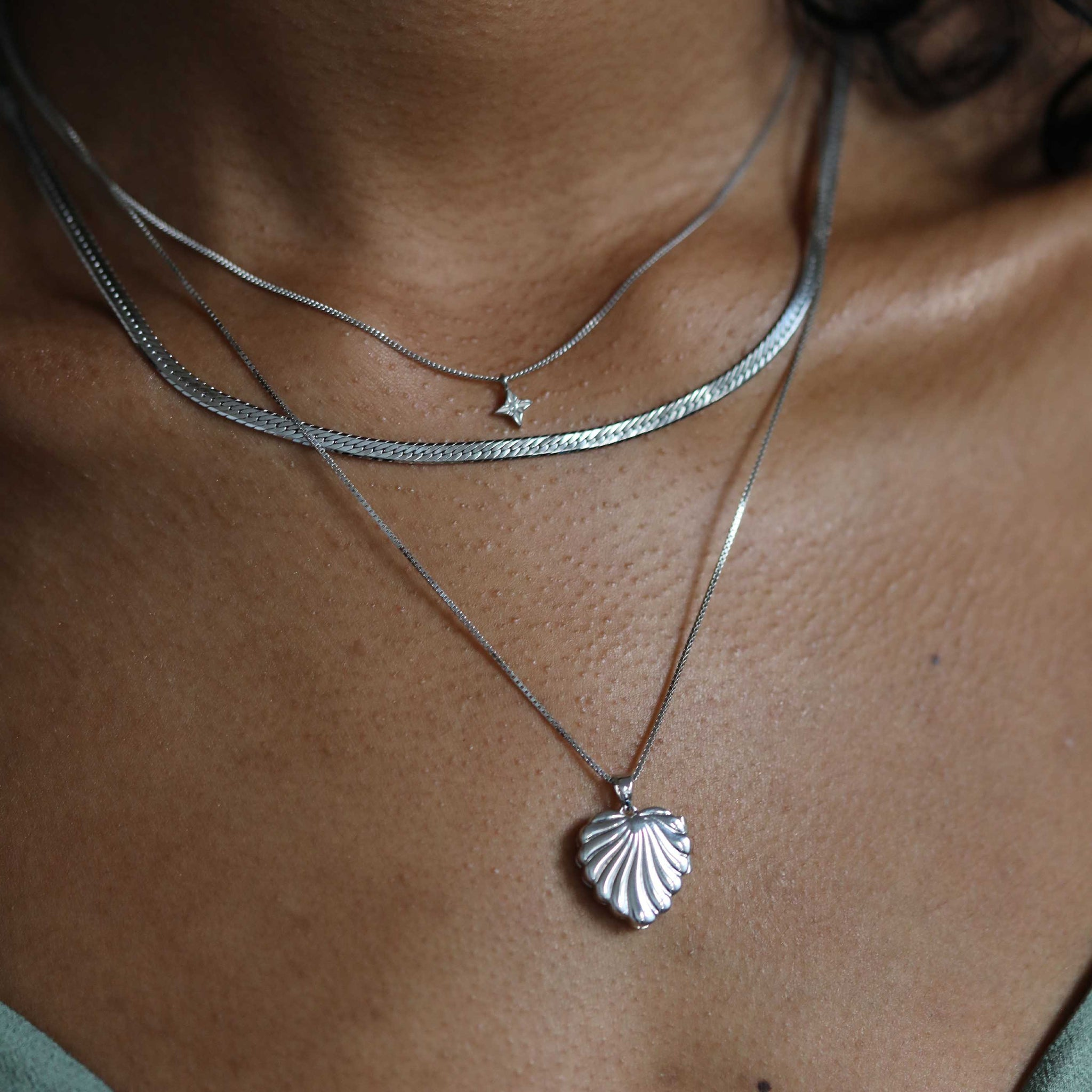 etched star pendant necklace worn with locket