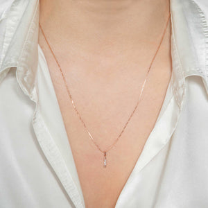 Arrow Necklace Charm in Rose Gold worn on fine bar chain