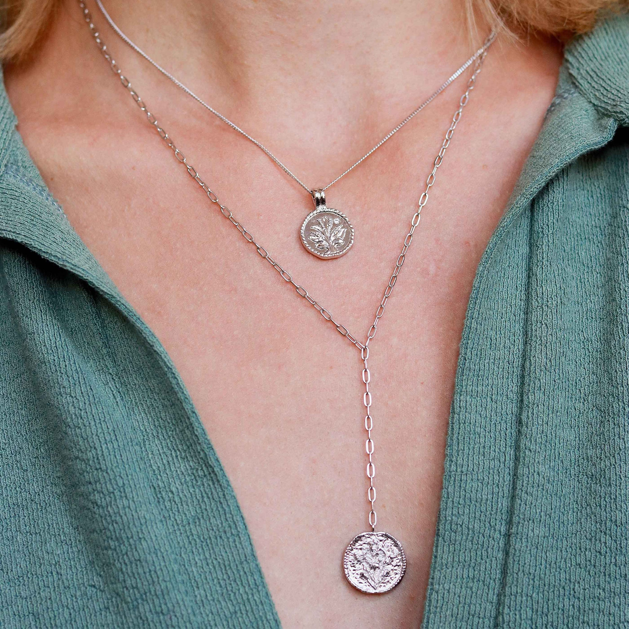 Blossom Coin Pendant Necklace in Silver worn with lariat necklace