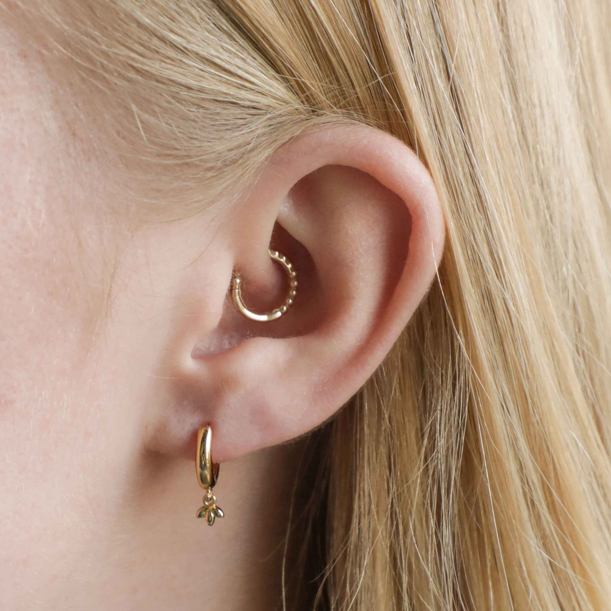 Botanist Pendant Hoops in Gold worn in first lobe piercing
