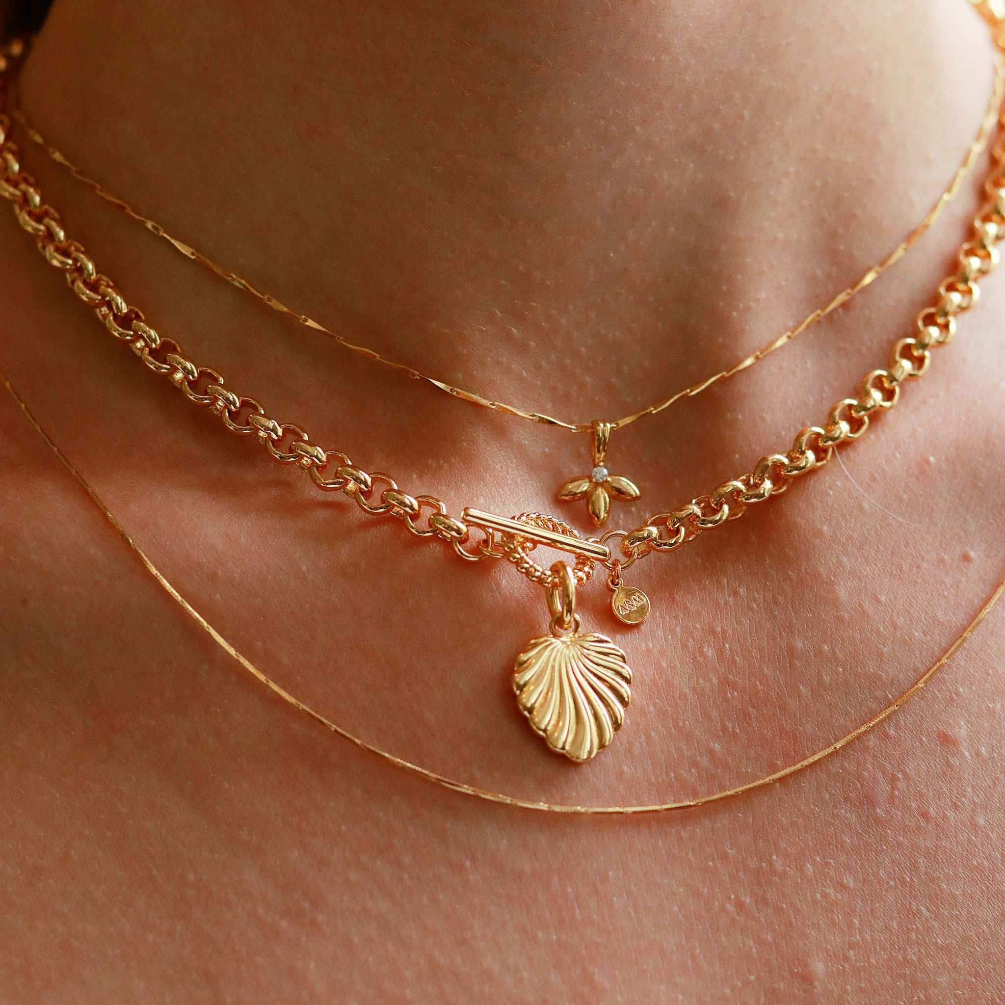 Botanist Pendant Necklace in Gold worn with chunky necklace