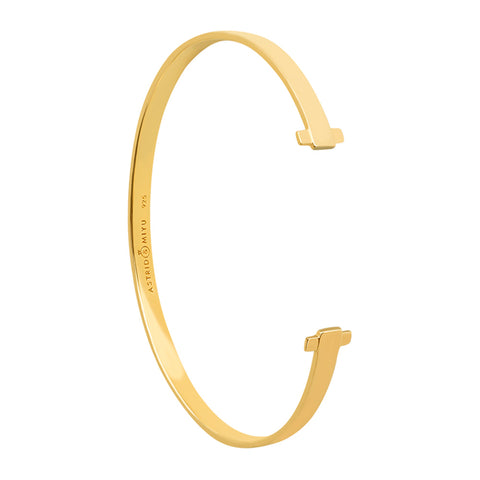 Gold crossing lines locking bangle