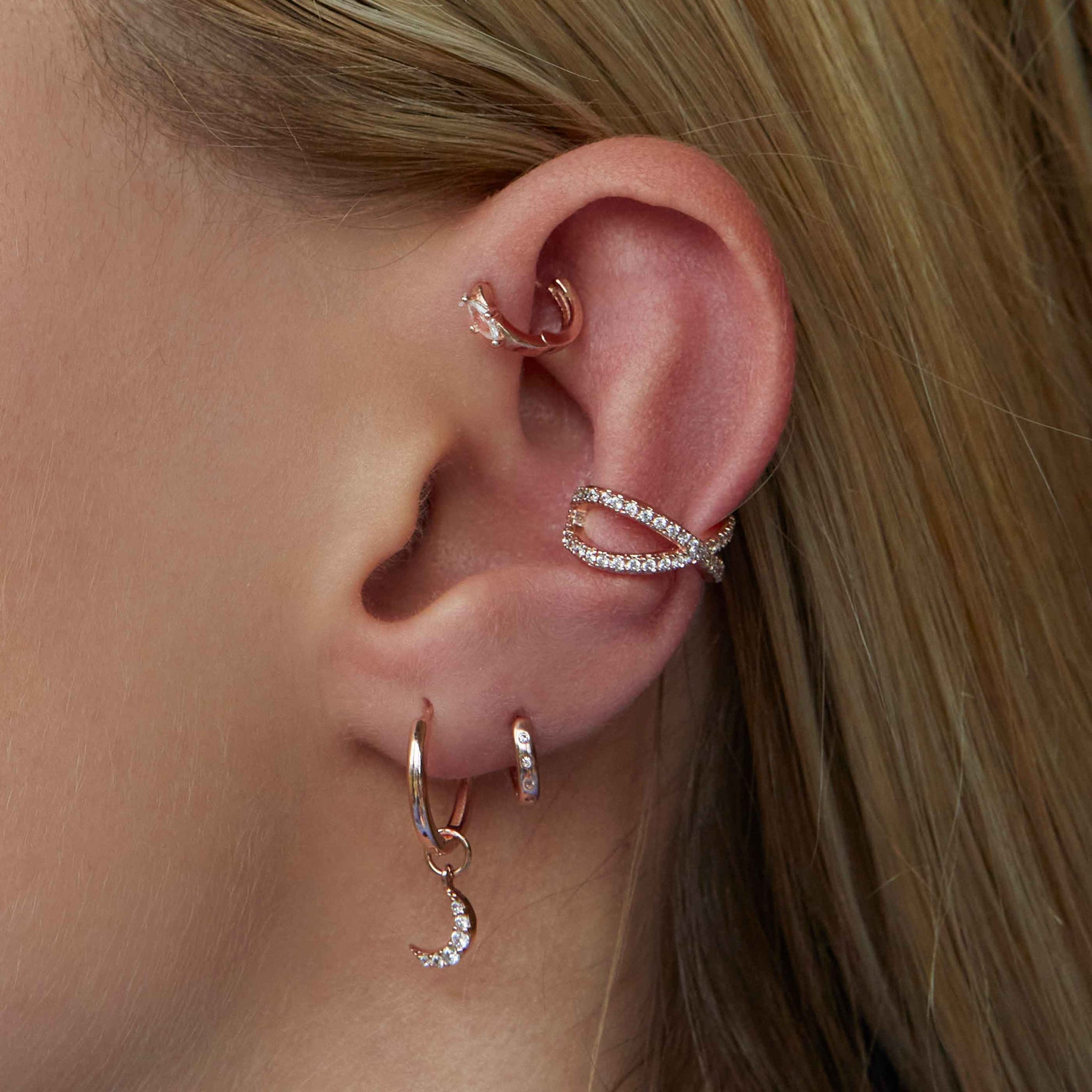crossover ear cuff worn with rose gold earrings