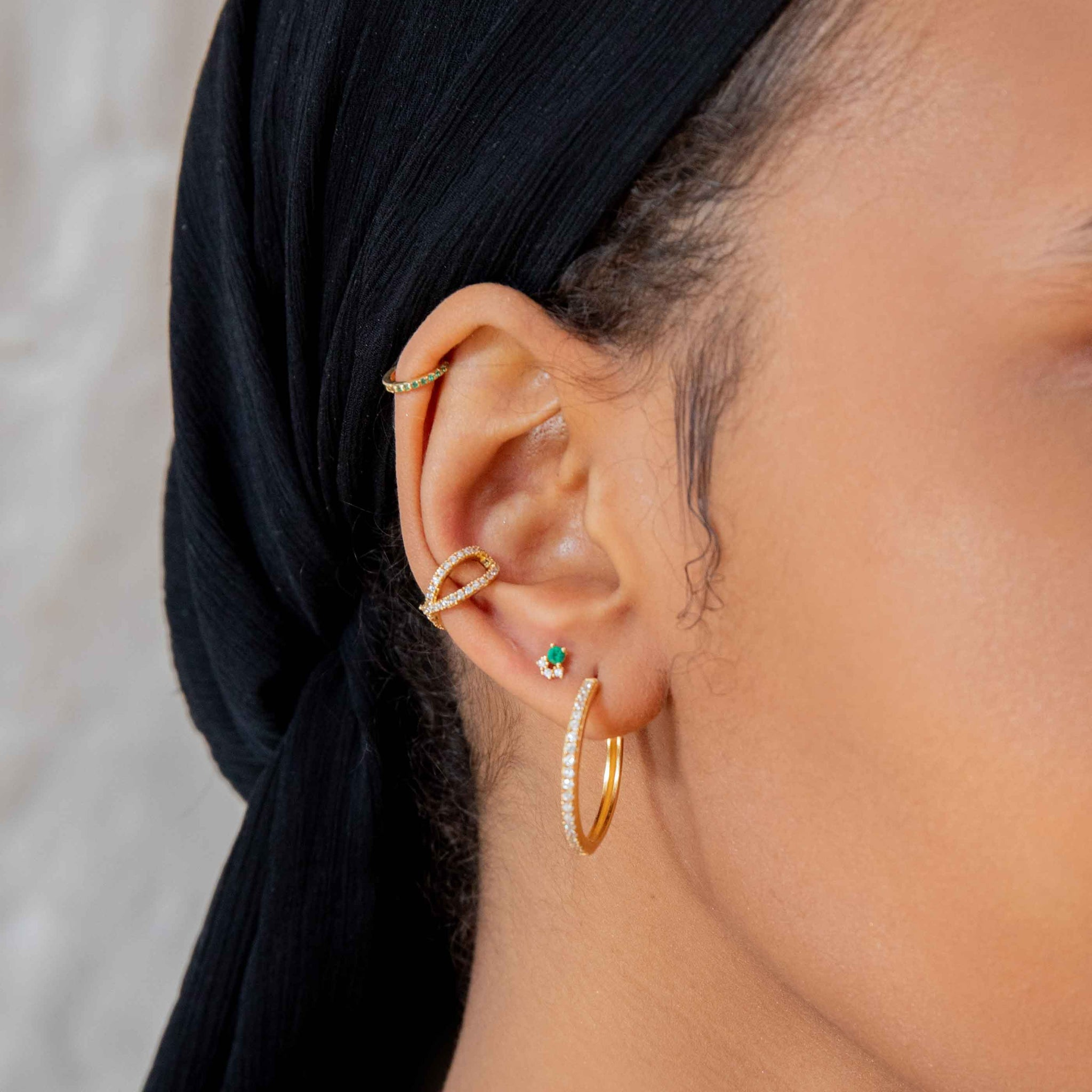 Crossover Crystal Ear Cuff in Gold worn with crystal hinge hoops