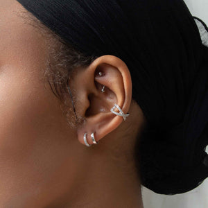 Crossover Crystal Ear Cuff in Silver worn with illusion stud earrings